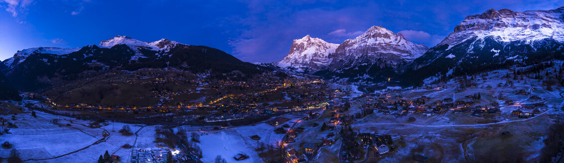 Switzerland, Canton of Bern, Wetterhorn, Grindelwald, townscape at blue hour in winter - AMF06759