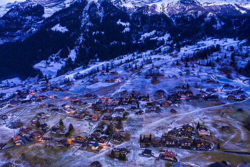 Switzerland, Canton of Bern, Wetterhorn, Grindelwald, townscape at blue hour in winter - AMF06762