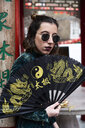 London, young woman with chinese fan in Chinatown - IGGF00763
