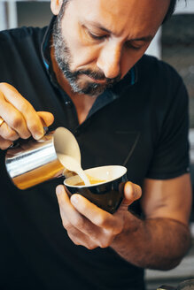 Barista preparing cappuccino in a coffee shop - OCMF00272