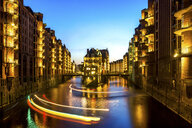 Germany, Hamburg, Wandrahmsfleet in the historic warehouse district at blue hour - PUF01366