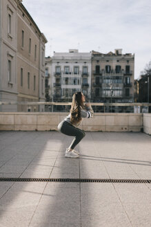 Young woman workout at city, Lleida, Catalonia, Spain. - JPF00345