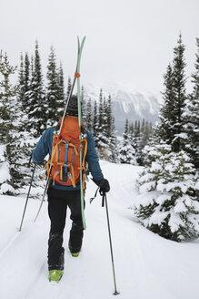 Male skier hiking in snow - HEROF19072