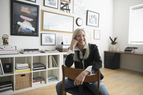 Smiling, confident, creative senior businesswoman entrepreneur in studio office - HEROF19633