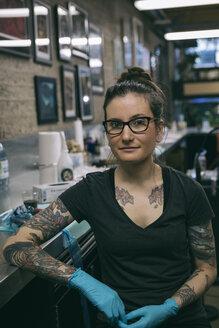 Portrait confident, determined tattoo artist in tattoo studio - HEROF19924