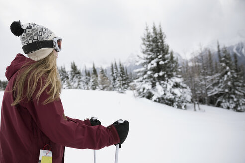 Teenage girl skier skiing in snow - HEROF20437