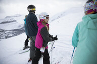 Girl skier skiing with family in snow - HEROF20629