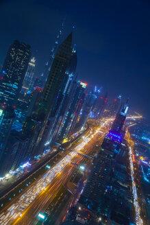 Skyscrapers along Sheikh Zayed Road at evening rush hour, Dubai, UAE - CUF48611