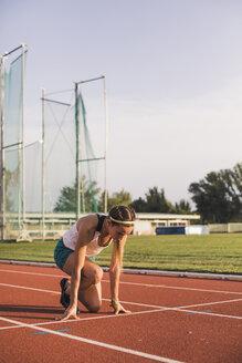 Female runner on tartan track starting - ACPF00450