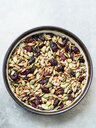 Variety of seeds and dried cranberries in bowl - CUF48725