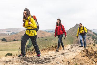 Hikers walking on ridge, Chrome Hill, Peak District, Derbyshire - CUF49247
