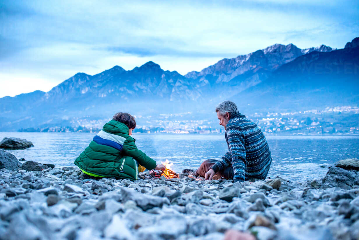 Father and son starting campfire, Onno, Lombardy, Italy - CUF49259 - Bonfanti Diego/Westend61
