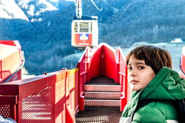 Boy at cable car station, Piani Resinelli, Lombardy, Italy - CUF49265