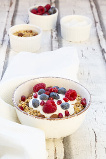 Bowl of muesli with Greek yogurt, popped quinoa, raspberries, blueberries and pomegranate seed - LVF07768