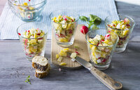 Glasses of cheese salad with red radishes and herbs - PPXF00151