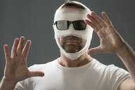 Man with gauze bandage, beauty craze - MAEF12795