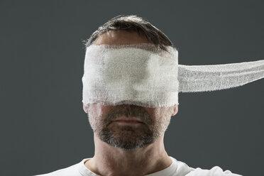 Man with gauze bandage, beauty craze - MAEF12798
