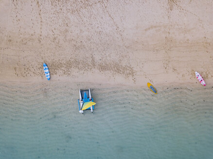 Indonesia, Bali, Nusa Dua beach, Sailboat, kayak and sup boards at the beach - KNTF02648