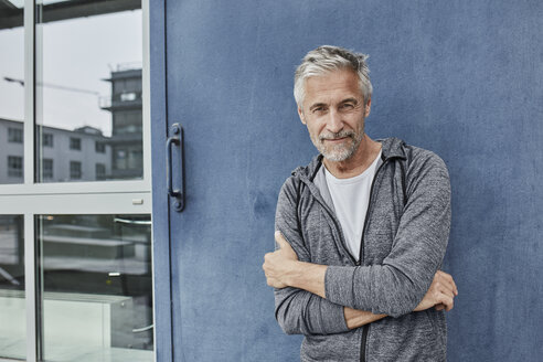Portrait of mature man in front of gym - RORF01736