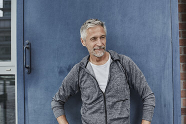 Portrait of mature man wearing tracksuit top in front of gym - RORF01739