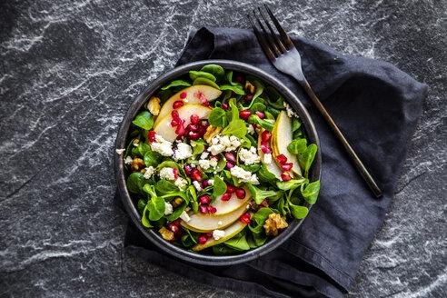 Bowl of mixed salad with lamb's lettuce, feta, pear, pomegranate seed and walnuts - SARF04103