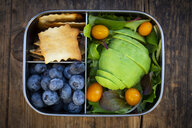 Lunch box of leaf salad, avocado, blueberries, tomatoes and crackers - LVF07781