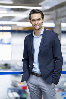 Portrait of confident businessman in a factory - DIGF05642
