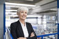 Portrait of confident senior businesswoman in a factory - DIGF05696