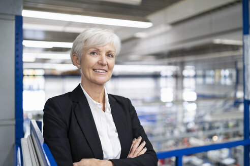 Portrait of confident senior businesswoman in a factory - DIGF05696