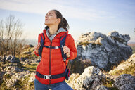 Woman on a hiking trip in the mountains having a break - BSZF00930