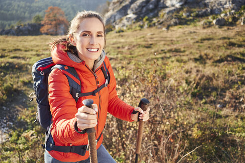 Portrait of smiling woman on a hiking trip in the mountains - BSZF00954