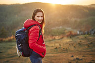 Portrait of smiling woman on a hiking trip in the mountains - BSZF00987