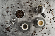 Cup of black coffee, cup of espresso coffee spoons and coffee beans - AFVF02353