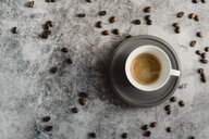 Cup of espresso and scattered coffee beans - AFVF02356