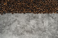 Coffee beans on grey marbled background - AFVF02383