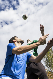 Soccer players jumping to hit the ball with head during a soccer match. - ABZF02191