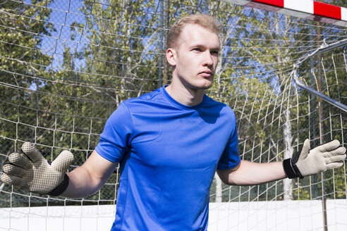 Portrait of focused goalkeeper playing in goal - ABZF02203