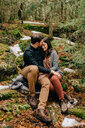 Couple hugging in forest, Tobermory, Canada - ISF20638