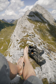 Austria, Tyrol, point of view shot of man's legs in mountainscape - FKF03260