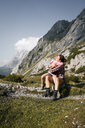 Austria, Tyrol, happy mother and daughter hugging in mountainscape - FKF03281