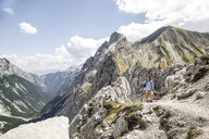 Austria, Tyrol, woman on a hiking trip in the mountains - FKF03302
