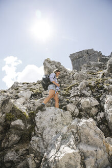 Austria, Tyrol, woman on a hiking trip in the mountains - FKF03305