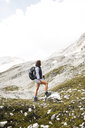 Austria, Tyrol, woman on a hiking trip in the mountains - FKF03311