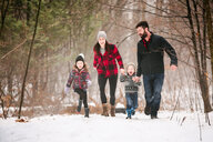 Family on walk in snow landscape - ISF20837