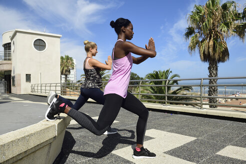 Two women doing fitness exercises outdoors - ECPF00486