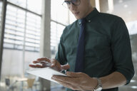 Businessman using digital tablet - HEROF21145