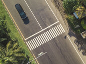 Indonesia, Bali, Sanur, Aerial view of car at zebra crossing on the road - KNTF02662