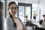 Portrait confident businesswoman in conference room meeting - HEROF21308