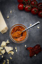 Glass of tomato pesto and ingredients - LVF07784