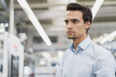 Portrait of a serious businessman in a factory - DIGF05789